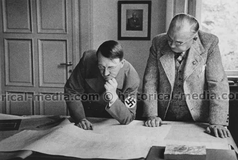 Adolf Hitler during a visit to the atelier of architect Woldemar Brinkmann, he is shown the plans for Munich's opera and Berlin's Reichstag