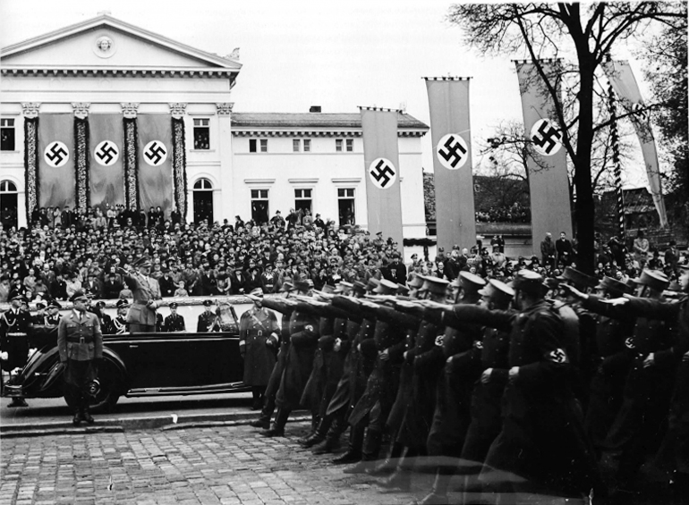 Adolf Hitler salutes the parade for the Gauparteitag in Weimar
