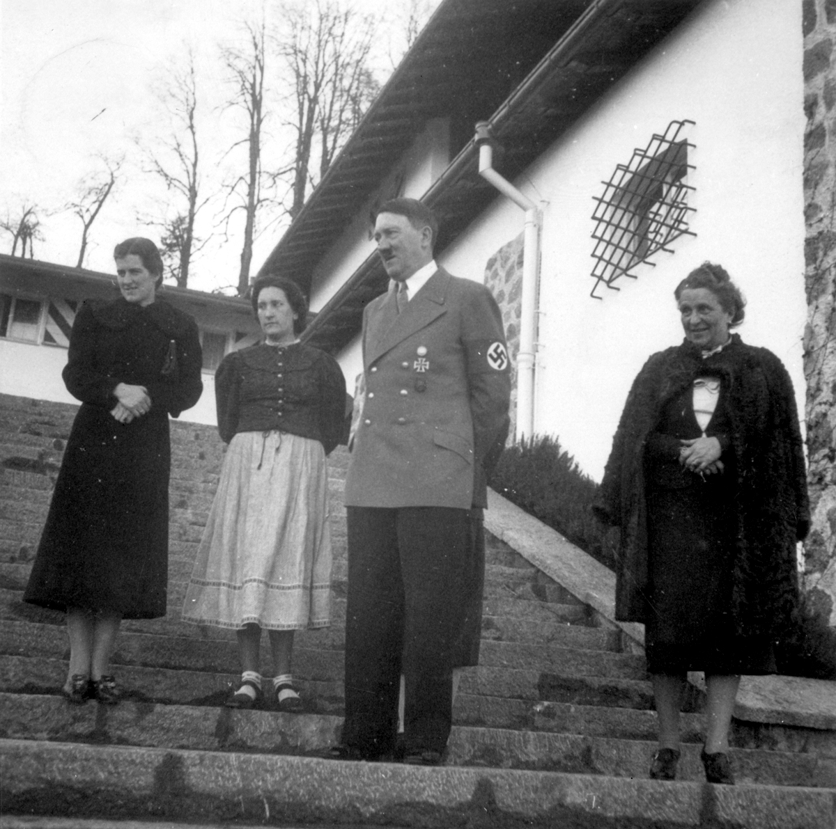 Adolf Hitler on the stairs of the Berghof before Franz Xaver Schwarz and his wife's visit for Scharz's birthday, from Eva Braun's albums