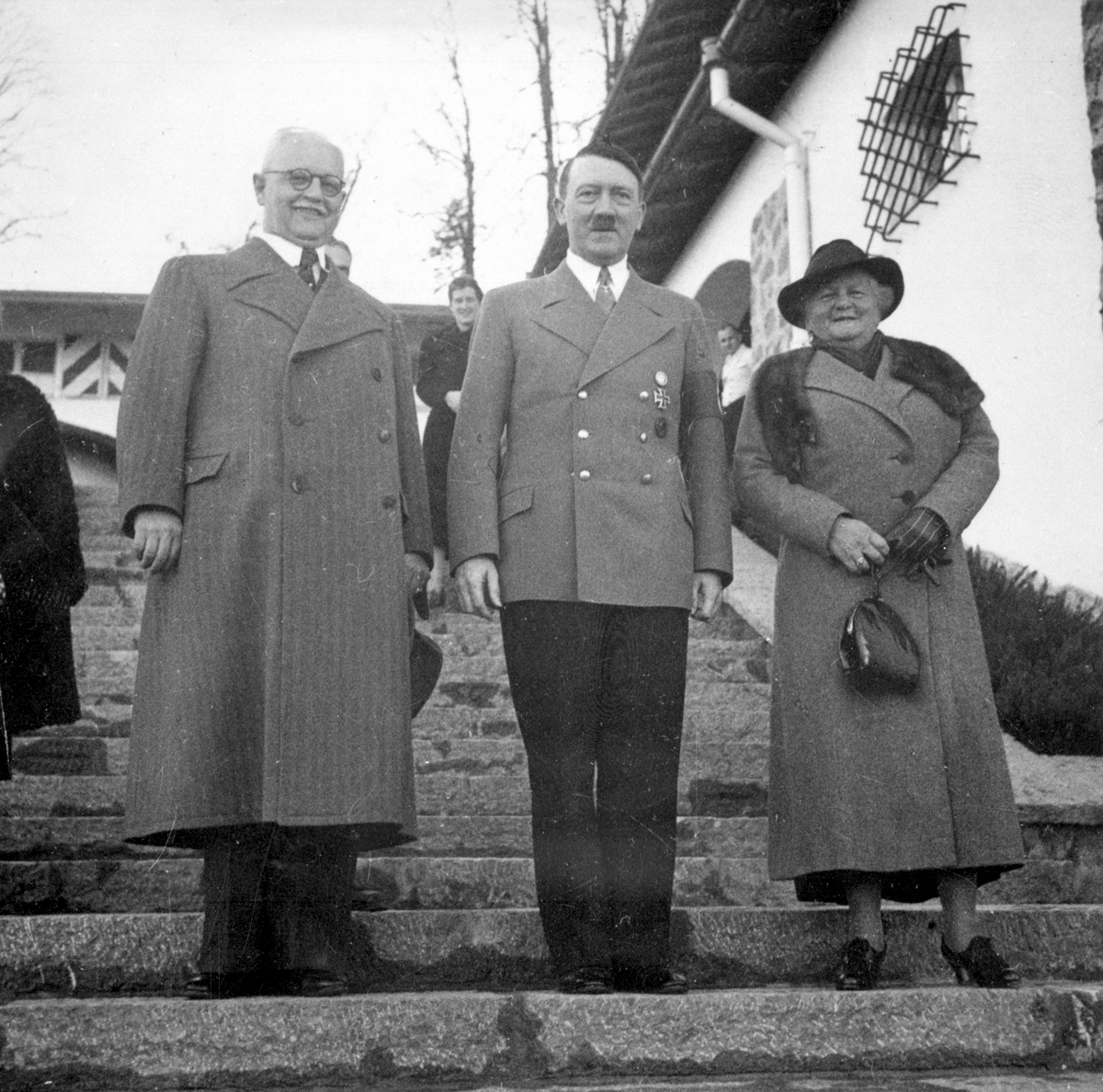 Adolf Hitler welcomes Franz Xaver Schwarz and his wife at the Berghof for his birthday, from Eva Braun's albums