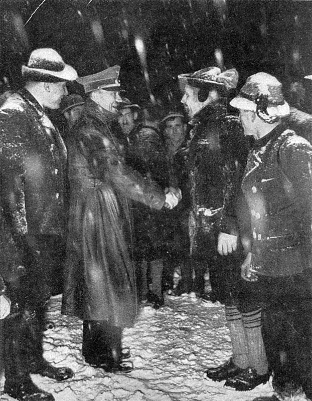 Adolf Hitler greets the Berchtesgadener Weihnachtsschützen on New Year's Eve