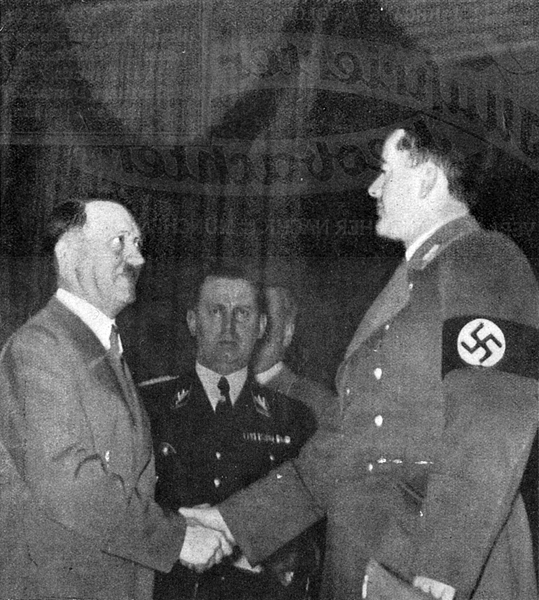 Adolf Hitler greets Albert Speer in Berlin's Sportpalast on the occasion of the inauguration of the new chancellery