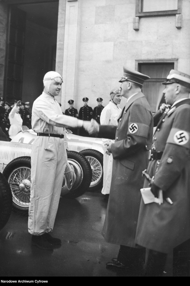 Adolf Hitler greets motorcyclists in white suits during the International Motor Show in Berlin