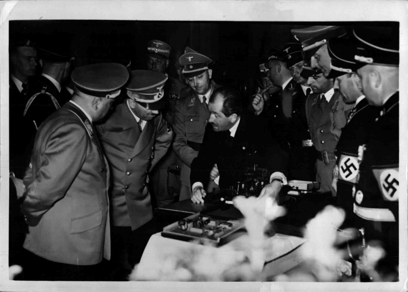 Ferdinand Porsche shows Adolf Hitler a tractor model