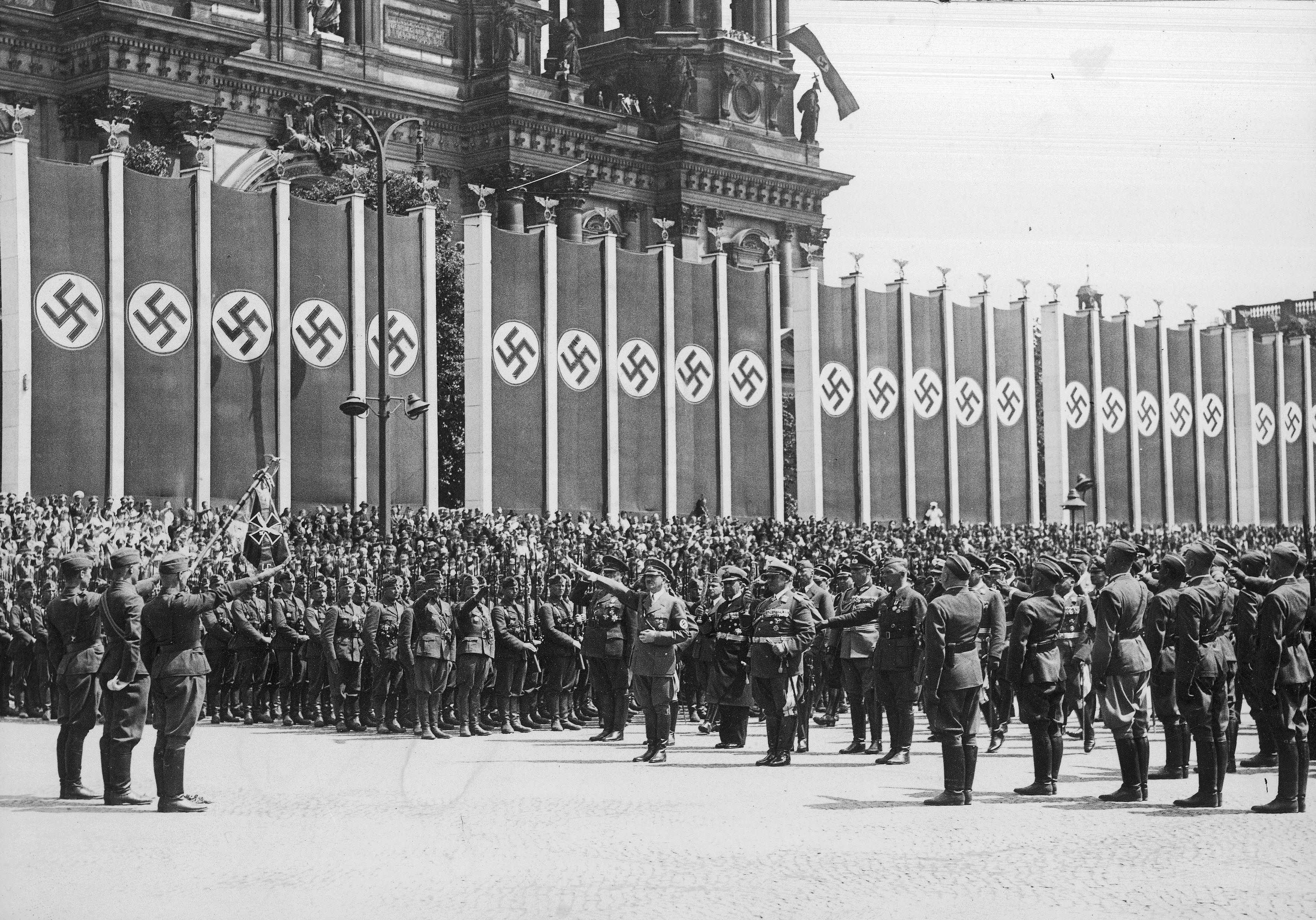 Adolf Hitler and Hermann Görinf salute the flag after the return of Legion Condor in Berlin
