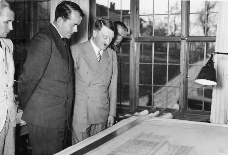 Adolf Hitler and Albert Speer inspect the plans for the new Linz opera in Speer's atelier