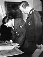 Adolf Hitler signs the call to the German nation in the Reich Chancellery after Great Britain and France declare war to Germany