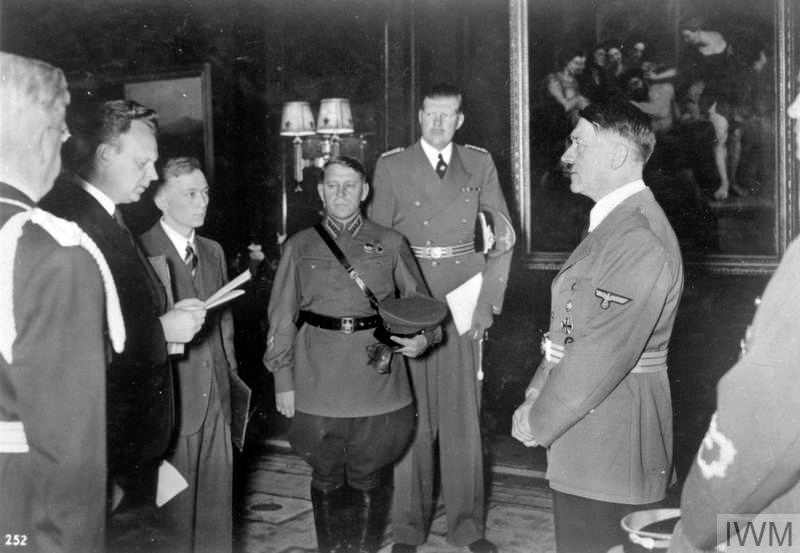 Alexander Schkwarzew, Soviet Ambassador reads his letters of accreditation to Adolf Hitler, with the Russian Military Attache, General Maksim Purkayev