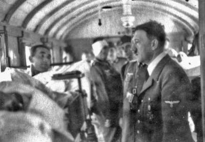 Adolf Hitler talking to wounded German soldiers in a sickbay near the eastern front in Poland