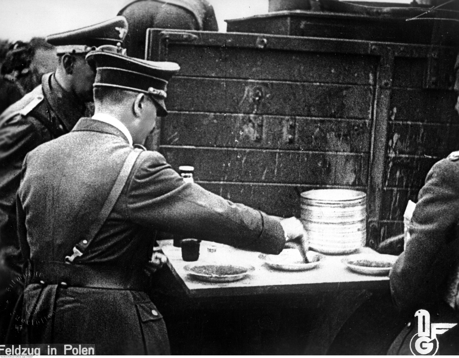 Adolf Hitler taking a lunch break at the field kitchen near the front line in Poland