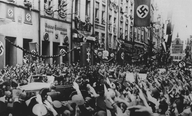 Adolf Hitler (standing at front of car) enters Danzig. The Danzig District was incorporated into Greater Germany following the invasion of Poland