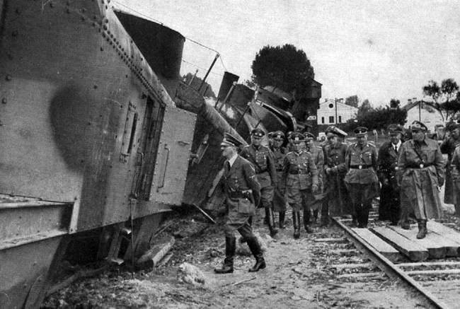 Adolf Hitler heads for a closer look at the second artillery carriage of the destroyed Polish armoured train No 13 General Sosnkowski