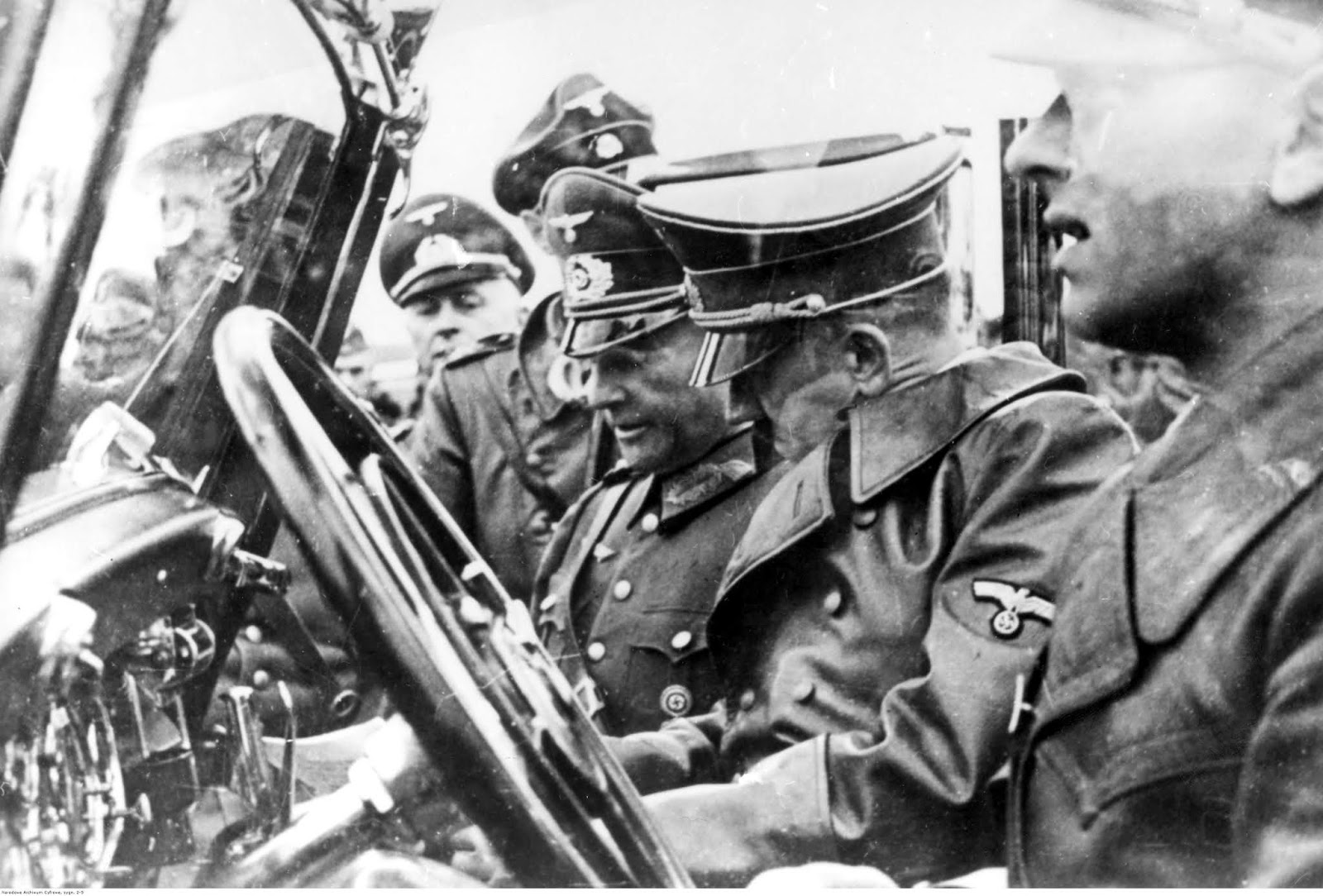 Adolf Hitler during a visit to Kriegsmarine base in Wilhelmshaven with Walther von Brauchitsch and his chauffeur Erich Kempka