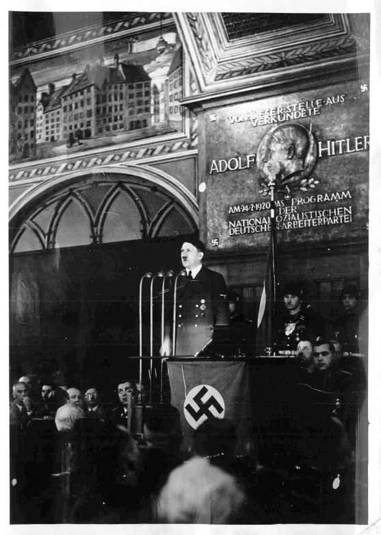 Adolf Hitler making a speech for the Parteigründungsfeier in the Hofbraühaus Munich, with a nice view of the24 2 1920 commemorative plaque