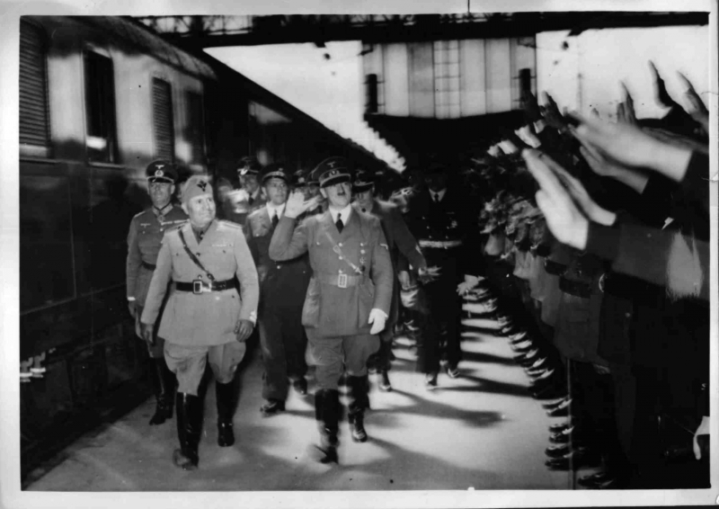 Adolf Hitler and Benito Mussolini greet the crowd in Munich's station