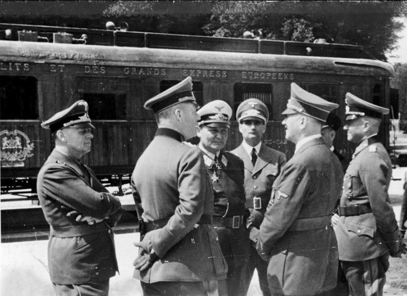 Adolf Hitler and his staff in front of the armistice wagon in Compiegne. Hitler had ordered that the same railway coach  from the 1918 armistice would be used for the 1940 armisitce with France