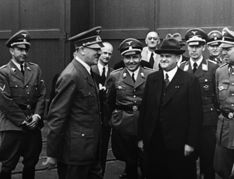 Adolf Hitler in front of the Krupp factory before his visit