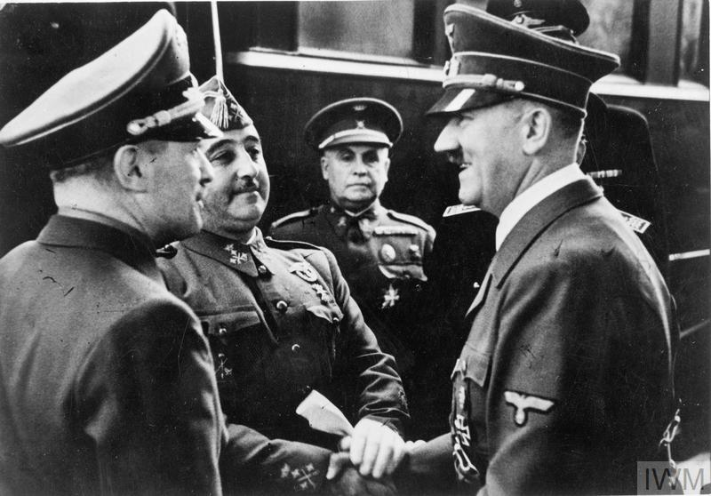 Adolf Hitler greets Francisco Franco in Hendaye near the Spanish border. The meeting could not take place in Spain as the Spanish railways did not have the same size as the French ones at the time, both trains had to stop at each country's border