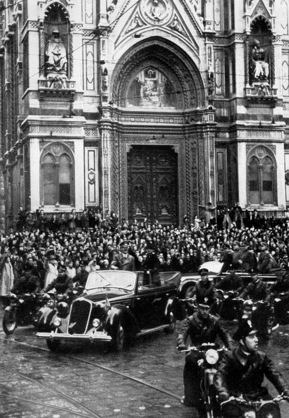 Adolf Hitler and Benito Mussolini are welcomed by the crowd in front of the cathedral of Florence