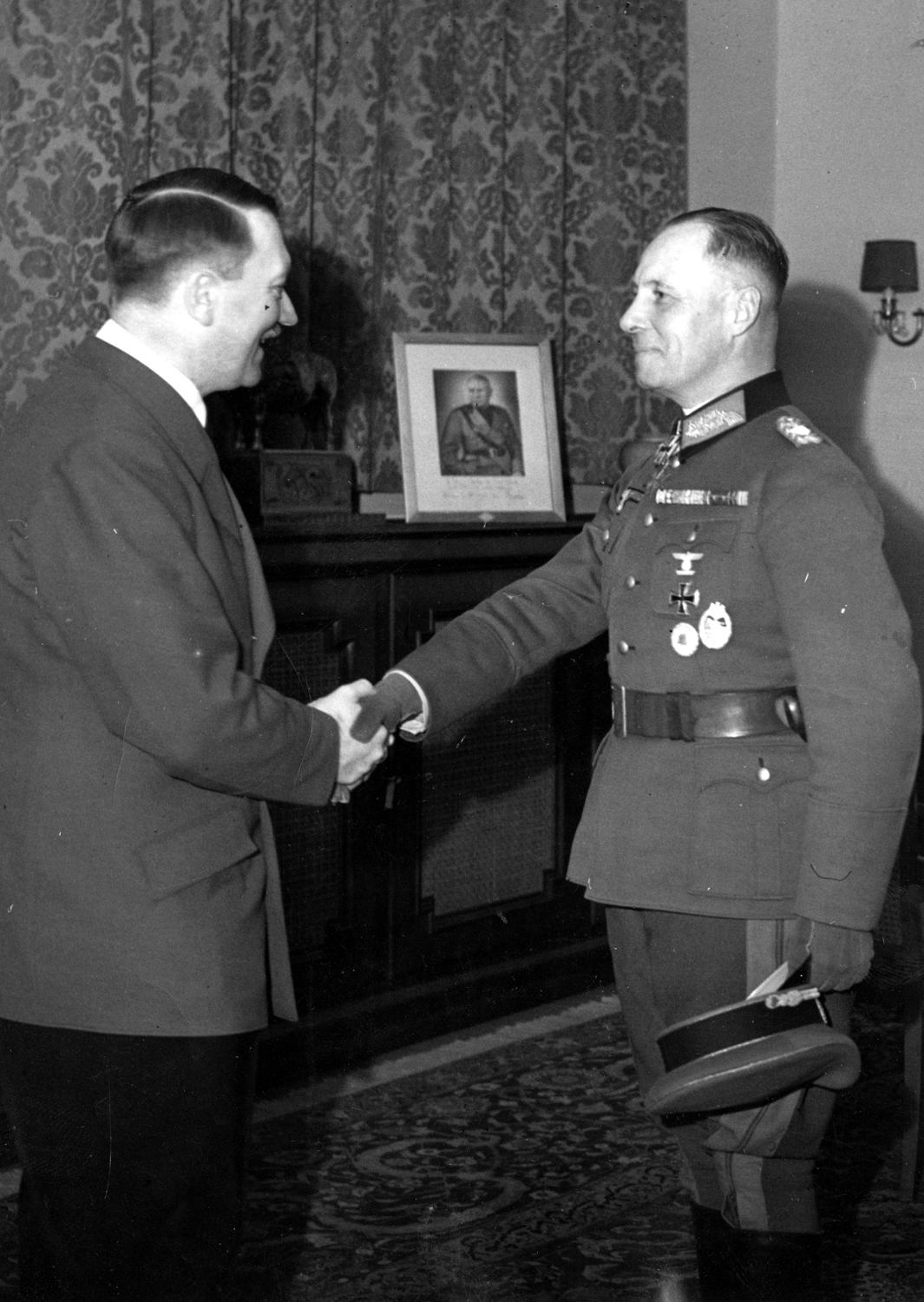 Adolf Hitler awards Erwin Rommel with the Knight's Cross of the Iron Cross