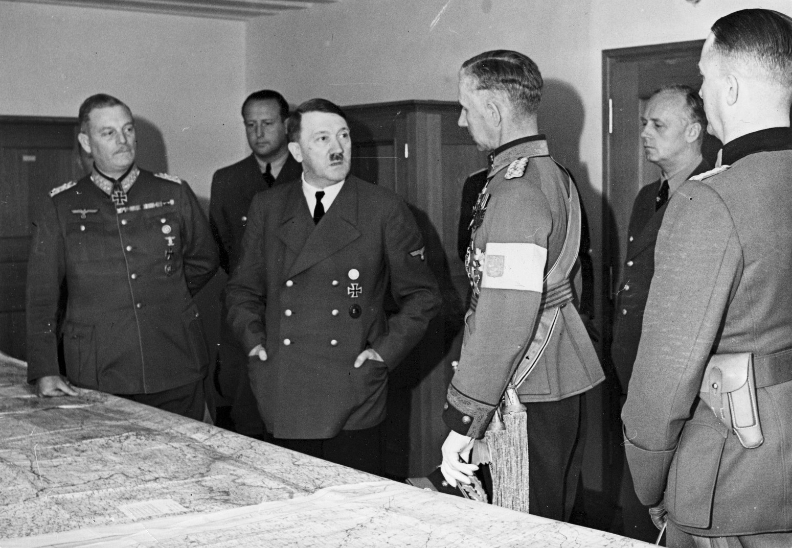 Adolf Hitler at a situation conference with general Wilhelm Keitel, lieutenant general of the Finnish army Harald Öhquist, Joachim von Ribbentrop and general Gerhard Matzky in FHQ Wolfsschanze