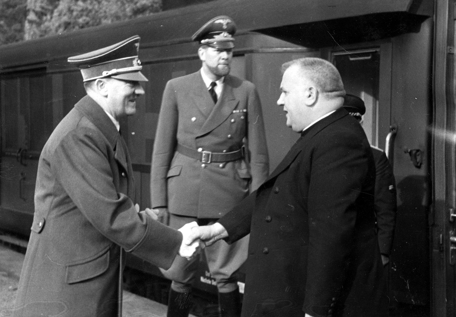 Adolf Hitler greeting the slovakian president Dr. Jozef Tiso at the station near Wolfsschanze, the head of the Protocol Department of the Foreign Office Alexander von Dörnberg is between them