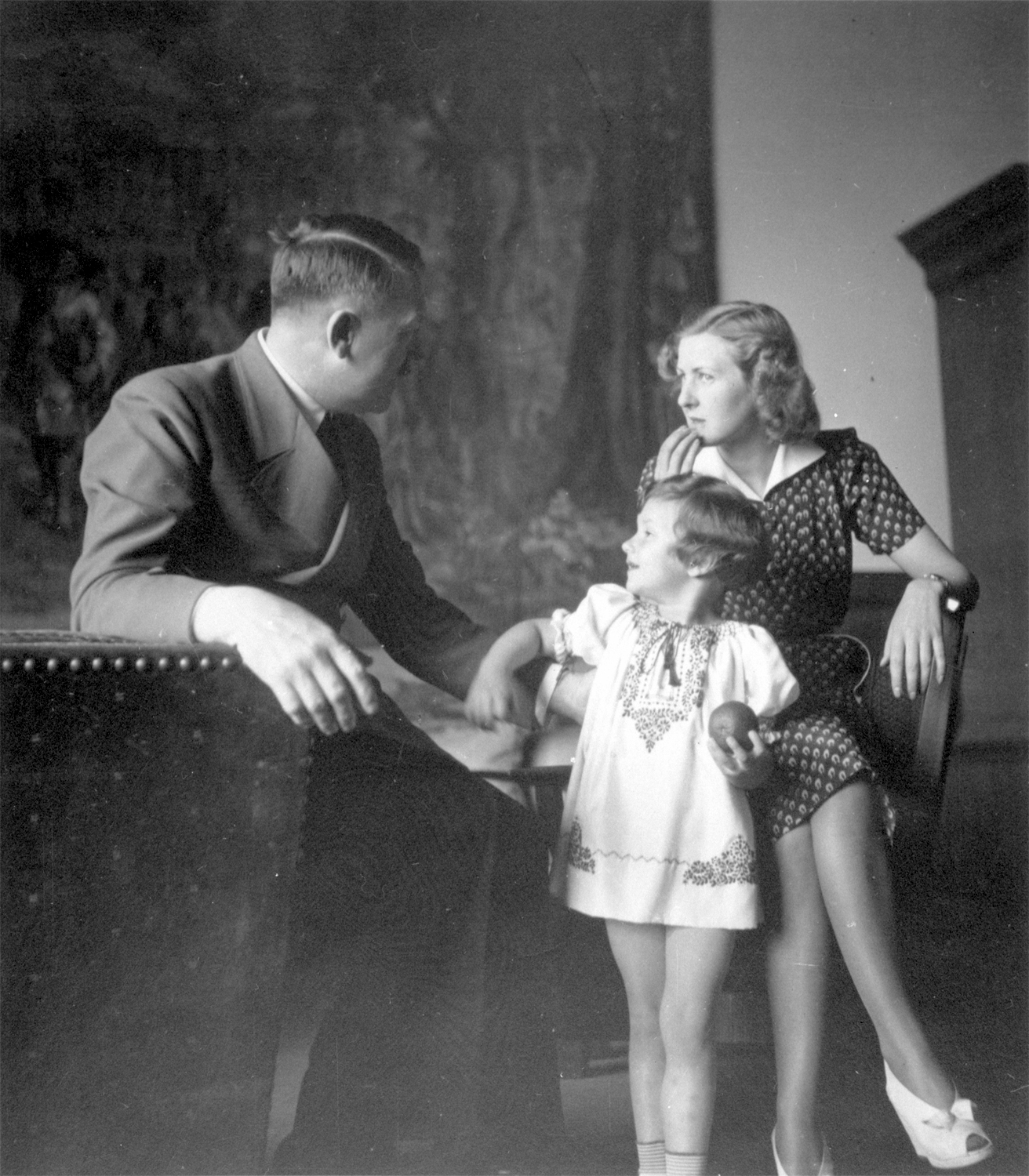 Adolf Hitler with Eva Braun and Uschi Schneider in the Berghof great hall, from Eva Braun's albums