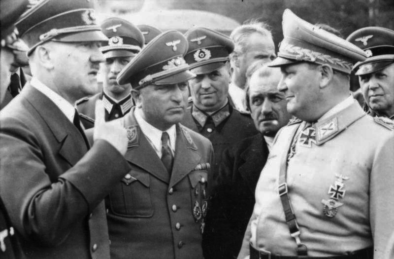 Adolf Hitler in conversation with Robert Ley, Ferdinand Porsche and Hermann Göring at FHQ Wolfsschanze