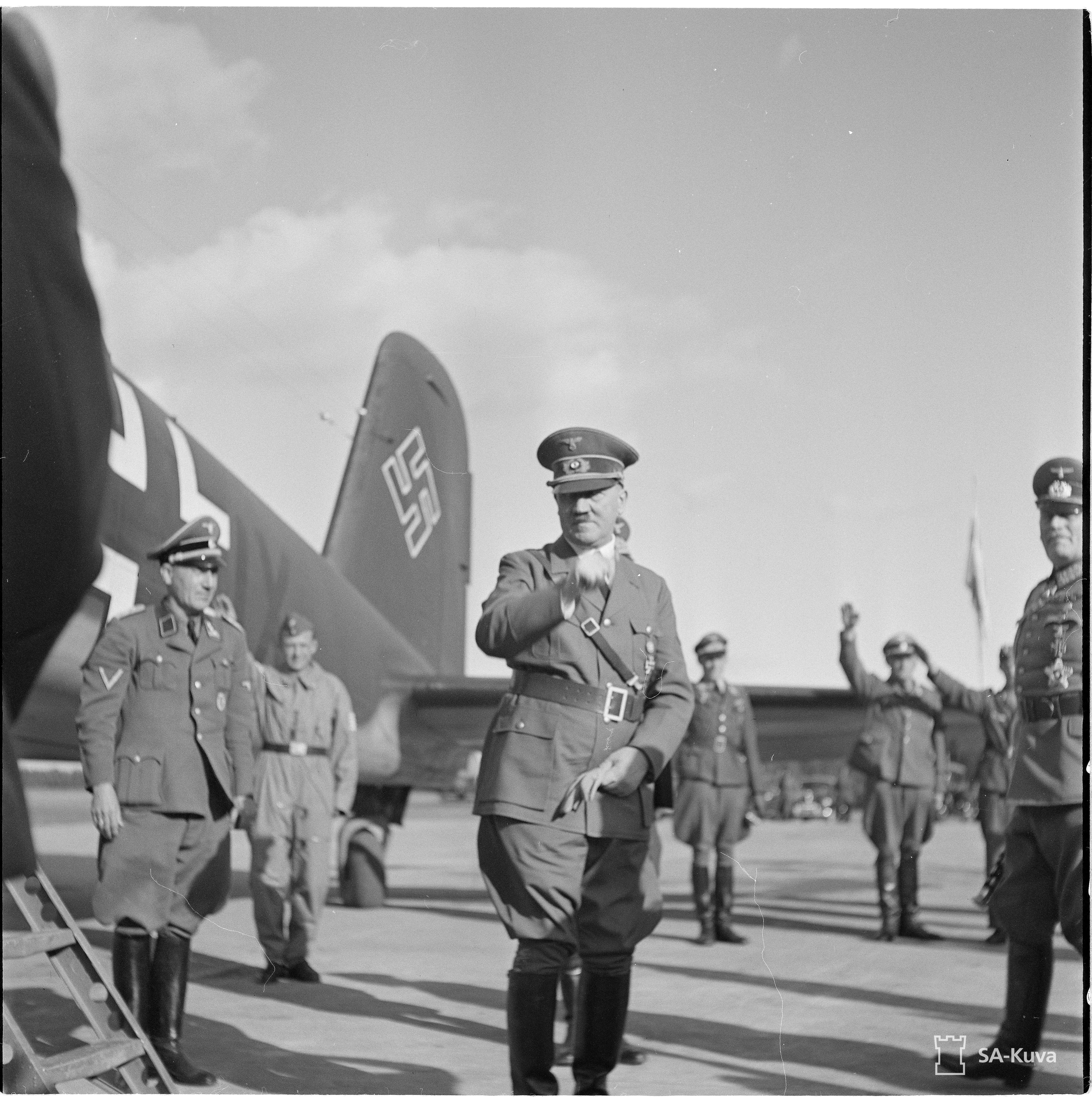 Adolf Hitler at his arrival in Finland in front of his Focke-Wulf Fw 200 Condor