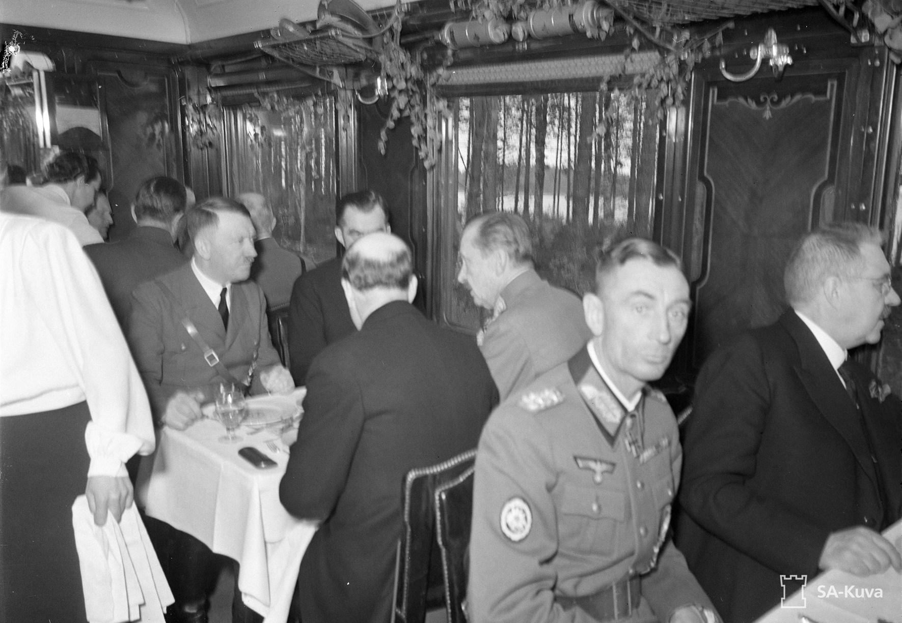 Adolf Hitler dining in the train with Finnish Prime Minister Jukka Rangell, President Risto Ryti and Marshal Carl Gustav Mannerheim