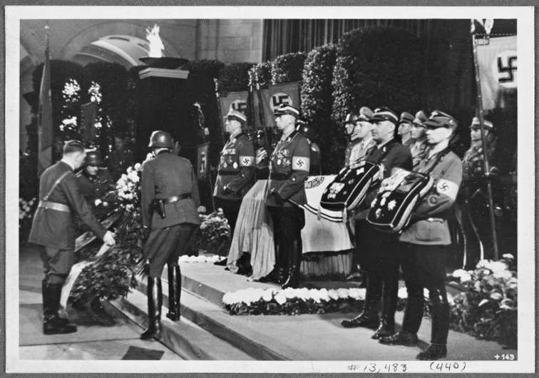 Adolf Hitler lays a wreath at the funeral of NSKK leader Adolf Huenlein