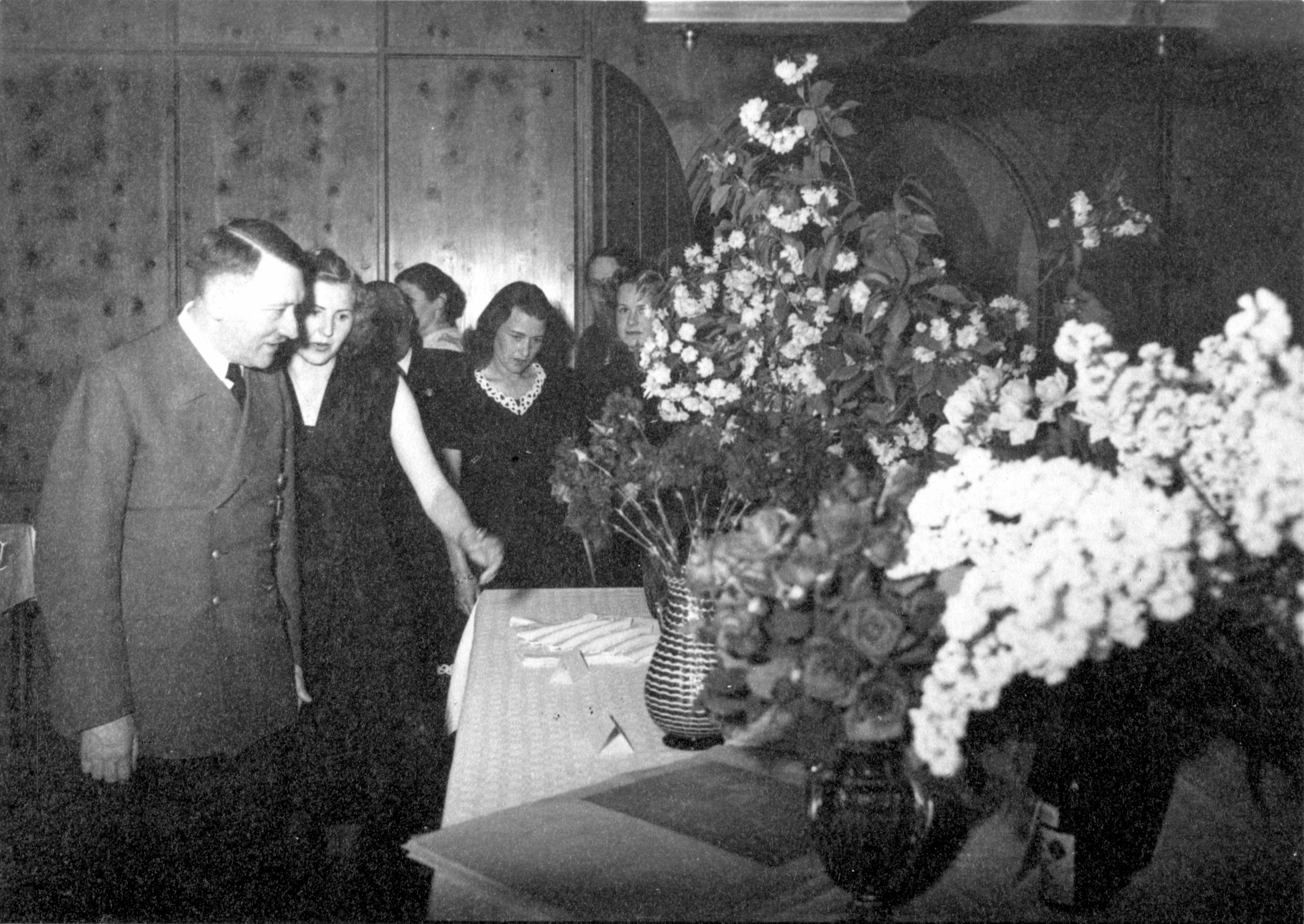 Adolf Hitler and Eva Braun look at the gifts on the occasion of the 54th birthday of the Führer, from Eva Braun's albums