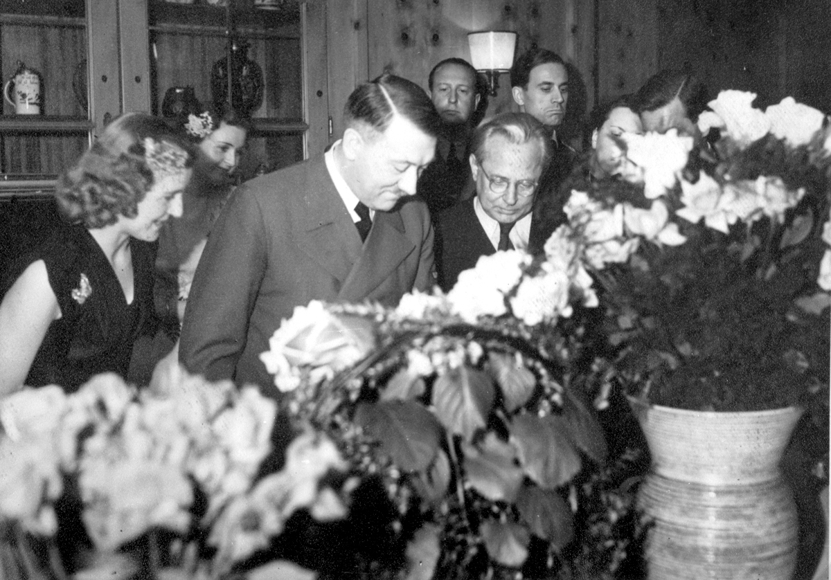 Adolf Hitler with Eva Braun and his photographer Heinrich Hoffmann during the 54th birthday celebration of the Führer, from Eva Braun's albums