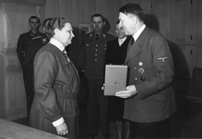 Adolf Hitler awards  Fanny Luukkonen, leader of the Finnish Lotta Svärd, a voluntary auxiliary organisation for women, with the Order of the German Eagle with Star