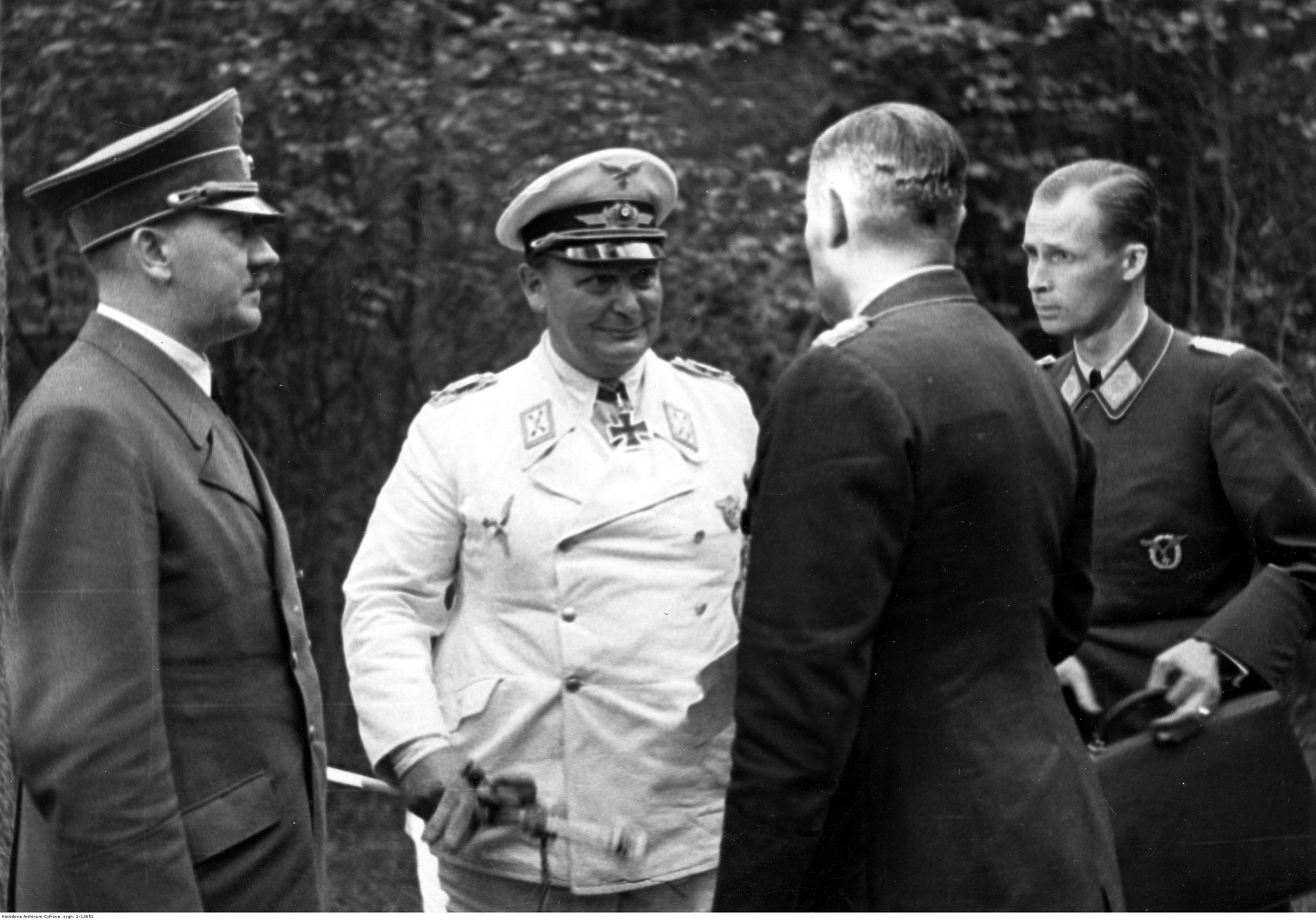 Meeting with Goering and general Karl-Heinrich Bodenschatz, liaison officer between the two leaders of the Party, in the forest of the Wolfschanze