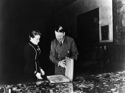 Adolf Hitler awards Hanna Reitsch the iron cross 2nd class in the Berghof great hall