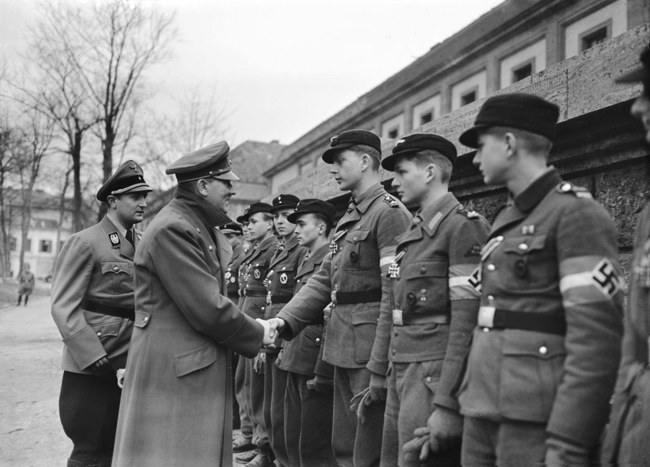 Adolf Hitler meets a group of Hitlerjugend in the chancellery garden during his last public appearance on camera