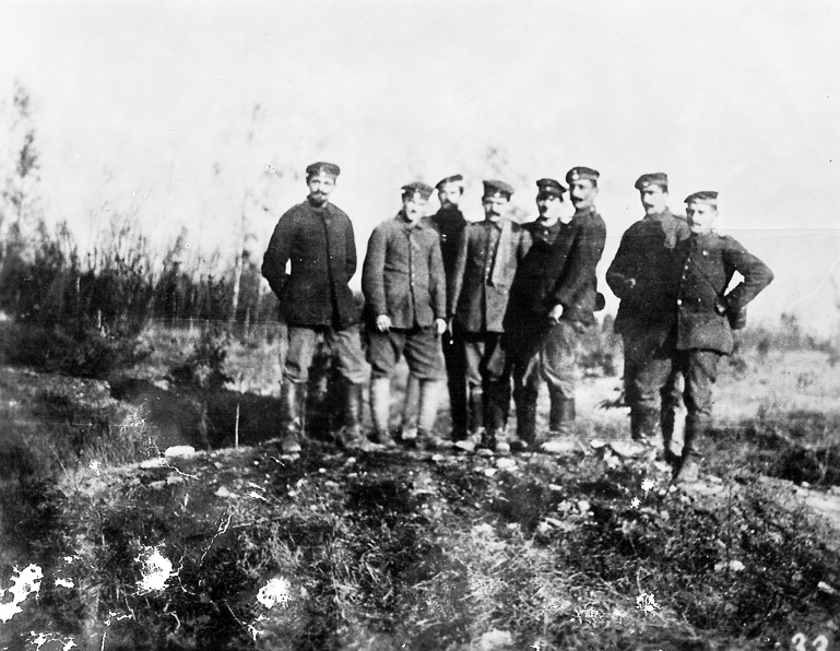 Adolf Hitler (4th from right) and his comrades in the fields near Fromelles, France