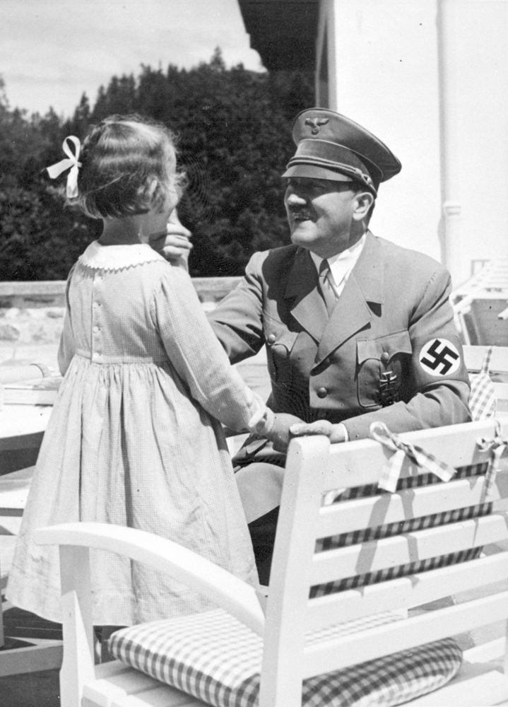Adolf Hitler with a little girl on the terrace of Haus Wachenfeld, from Eva Braun's albums