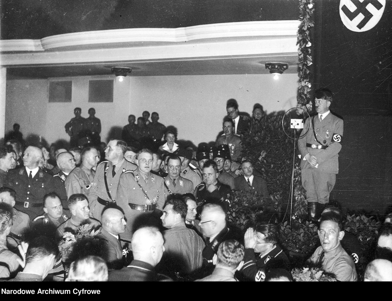 Adolf Hitler makes a speech to party members in Munich's Bürgerbräukeller for the 10th anniversary of the putsch attempt