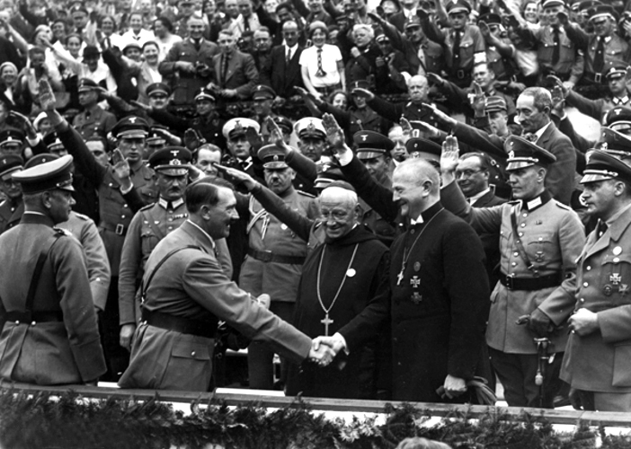 Hitler greets Reich Bishop Ludwig Muller and Abbott Albanus Schachleitner as Honorary guests at the Reich party rally for Unity and Strength