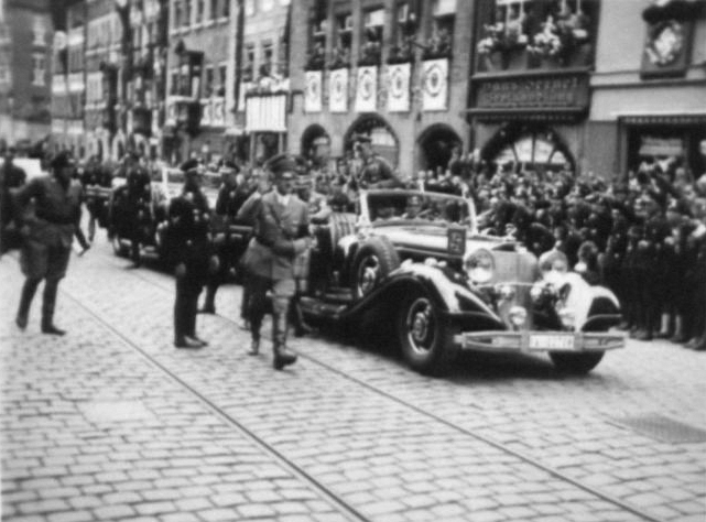 Adolf Hitler arrives at Nuremberg's town hall to open the 8th Reichsparteitag