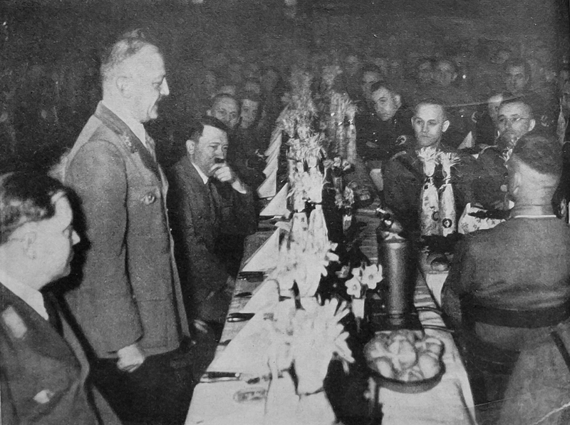 Adolf Wagner speaks at the Christmas party in Loewenbraeukeller
