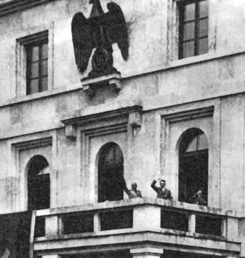 Adolf Hitler and Benito Mussolini wave at the crowd from the Führerbau balcony in München