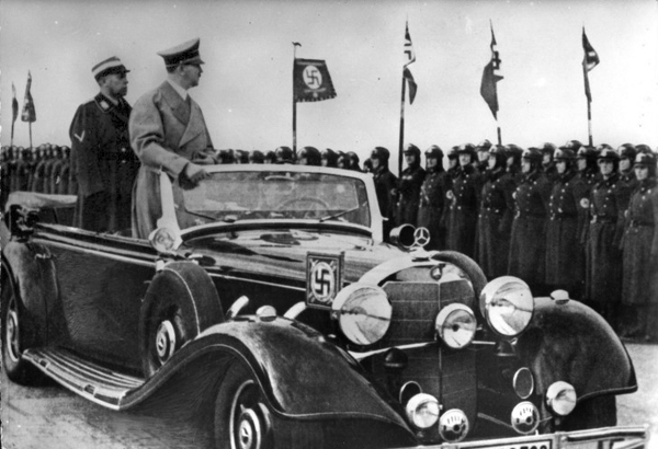 Adolf Hitler and Adolf Hühnlein in an open car on their way to the opening of the International Motor Show (IAMA) in Berlin