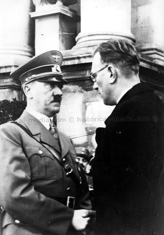Adolf Hitler shakes hands with Arthur Seyß-Inquart in front of the Hofburg's palace in Vienna