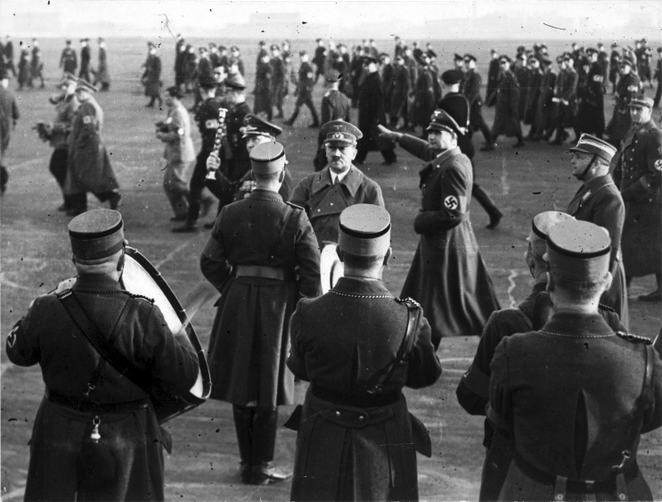 Adolf Hitler arrives in Berlin after his flight from Austria after the Anschluss