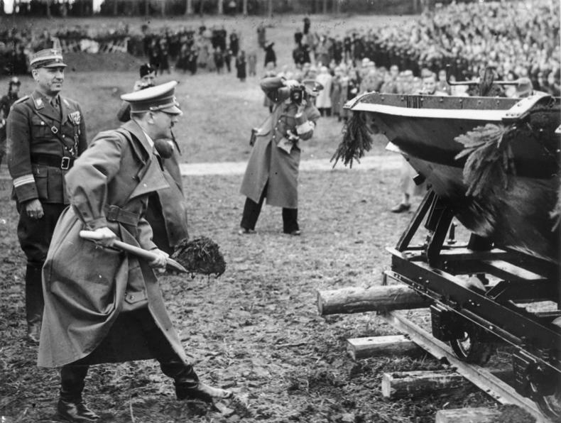 Adolf Hitler with a spade in front of decorated Lore in the groundbreaking ceremony of Reichsautobahn between Salzburg and Vienna