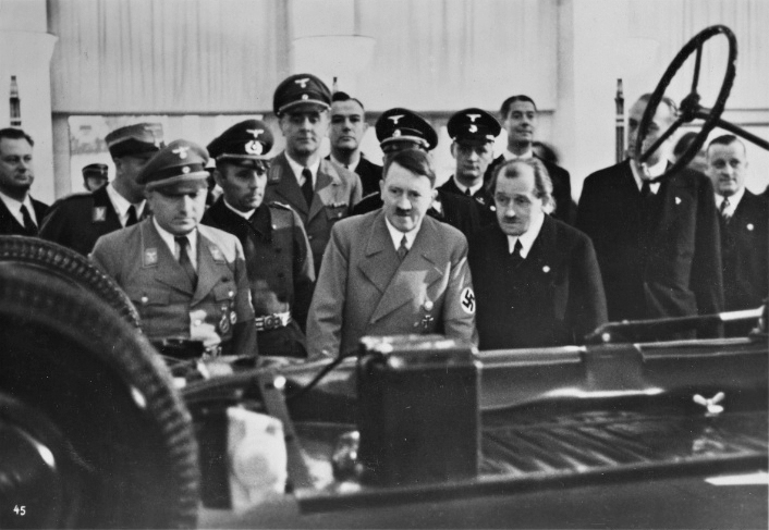 Adolf Hitler with Ferdinand Porsche and Robert Ley at the Volkswagen booth of the International Motor Show in Berlin