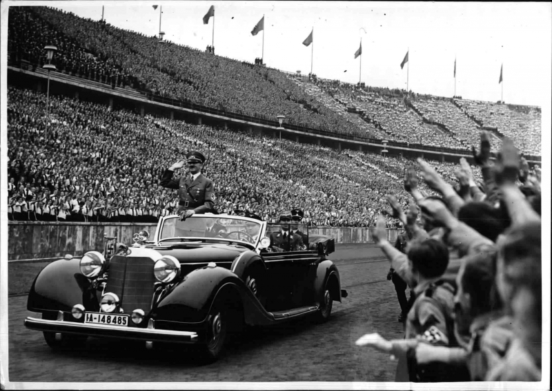 Adolf Hitler arrives in Berlin's Olympic stadium before his May Day speech to the Hitler Youth